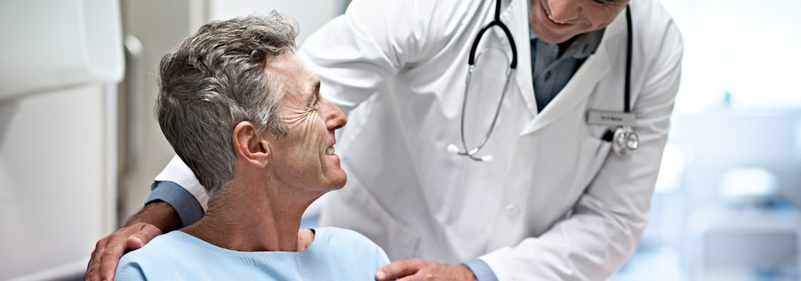 Doctor talking with patient about prostate cancer treatment options